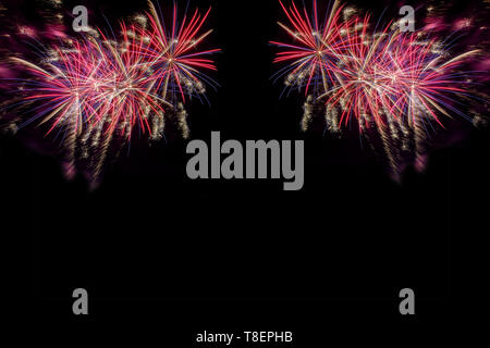 Bursting fireworks copyspace against black background celebrating the new year or the fourth of July indepence day  symmetrical - Stock Image
