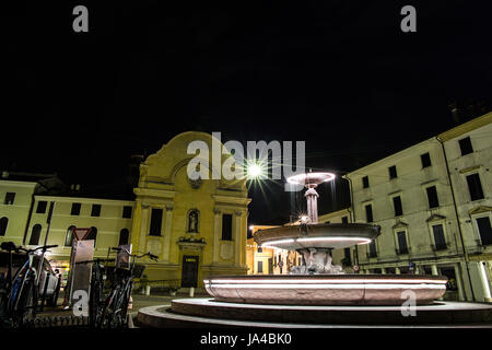 Church with illuminated fountain at night - Stock Image