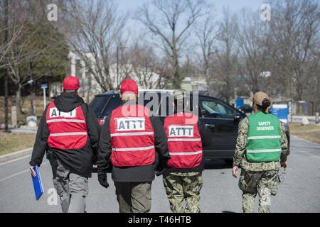Naval Support Activity Bethesda Anti-Terrorism Training Team members head to NSA Bethesda North Gate after the first part of a drill March 12, 2019. The practice scenario was part of the Regional Assessment (RASS) of security and emergency services. The inspection is conducted about a year after an installation completes the Command Assessment for Readiness and Training (CART). The final step in the inspection process will be the Final Evaluation Problem (FEP), which will allow base security forces to be certified for 18 months. - Stock Image
