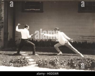 Two men fencing - Stock Image