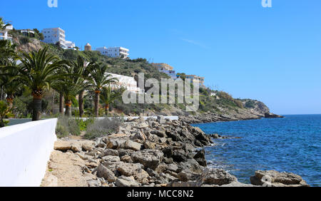 Beautiful sea view from the Island of Ibiza, Spain, Europe. Blue sky, sunlight, gorgeous turquoise sea and some plants and white buildings - amazing! - Stock Image