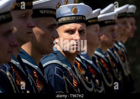 Sailors of the Black Sea fleet of the Russian Navy in the parade during a festive rally dedicated to the Day of the Black Sea fleet, Sevastopol city - Stock Image
