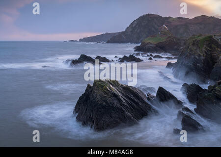 St Nicholas Chapel on the rugged cliffs of Ilfracombe at dawn, North Devon, England. Winter (January) 2018. - Stock Image