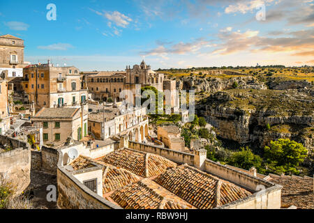 The Convent of Saint Agostino overlooks the canyon and the ancient sassi caves in the city of Matera, Italy. - Stock Image