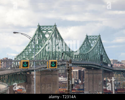 LONGUEUIL, CANADA - NOVEMBER 8, 2018:Pont Jacques Cartier bridge taken in the direction of Montreal, in Quebec, Canada on the Saint Lawrence river, It - Stock Image