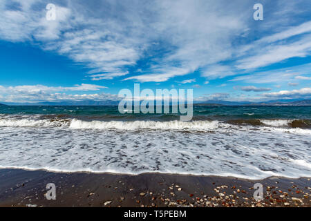 Dramatic view on dark blue stormy sea with big waves on Peloponnese, Greece - Stock Image