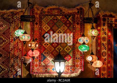 Turkish lamps and carpets on display in Icheri Sheher, Baku, Azerbaijan - Stock Image
