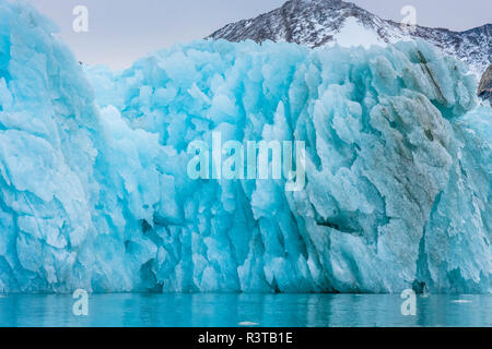 Greenland. East Greenland. Liverpool Land. Warming Island. Blue iceberg showing melting pattern. - Stock Image