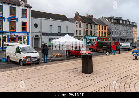 Bantry, West Cork, Ireland. 12th Oct, 2018. Despite a not very favourable weather forecast today, Bantry Market traders were still setting up their stalls early this morning after a night of heavy rain and winds which has left 30,000 homes around Ireland without power.  The storm is tracking northwards and will fizzle out by 5pm this evening. Credit: Andy Gibson/Alamy Live News. - Stock Image