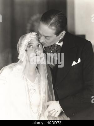 Groom kissing the bride - Stock Image
