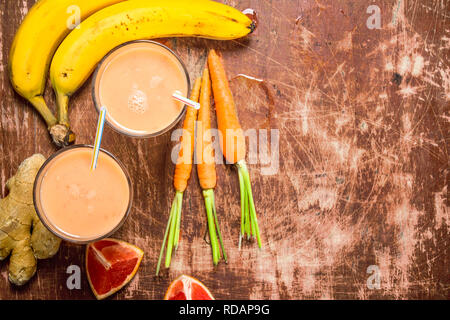Fresh fruit smoothie . On rustic background - Stock Image