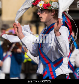 English morris dancers in traditional costume, including flowers and bells, performing in the village centre during the Joseph Arch centenary day. - Stock Image