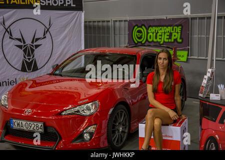 Bielsko-Biala, Poland. 12th Aug, 2017. International automotive trade fairs - MotoShow Bielsko-Biala. Toyota GT86 parked with a woman sitting next to it. Credit: Lukasz Obermann/Alamy Live News - Stock Image