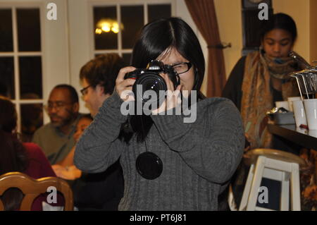Young female photographer - Stock Image