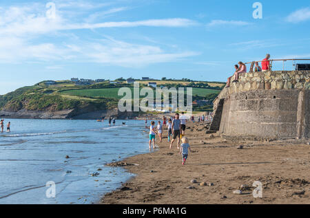 Broad Haven, Wales, UK. 30th June 2018. People enjoy the last of the June heatwave on the beach at Broad Haven and Littlehaven in South Wales. Credit Thomas Faull / Alamy Live News - Stock Image