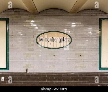 Wittenbergplatz U-Bahn underground railway station interior with tiled walls & station name, Berlin, Germany - Stock Image