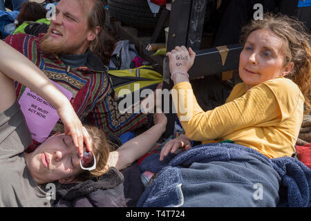Campaigners locked and glues to a yacht in the middle of the occupied Oxford Circus on day 4 of protests by climate change environmental activists with pressure group Extinction Rebellion, on18th April 2019, in London, England. - Stock Image