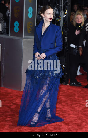 London, UK. 10th Feb, 2019. LONDON, UK. February 10, 2019: Lilly Collins arriving for the BAFTA Film Awards 2019 at the Royal Albert Hall, London. Picture: Steve Vas/Featureflash Credit: Paul Smith/Alamy Live News - Stock Image