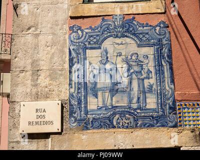 Portugal, Lisbon, Alfama, Old Town, Rua dos Remedios, 1749 religious themed tiled panel on street corner - Stock Image