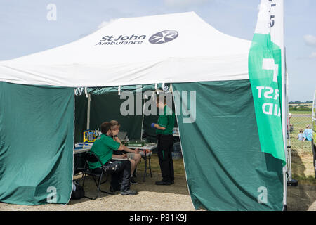 St John's first aid tent and personnel at Wings and Wheels - Stock Image