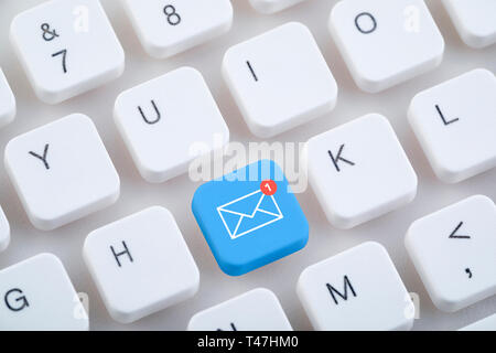 Computer keyboard with new email button. - Stock Image