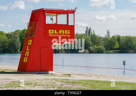 Langenhagen, Germany - May 15, 2019: Lifeguard station or tower by DLRG, which translates as German Life Saving Association, at bathing lake Silbersee. - Stock Image