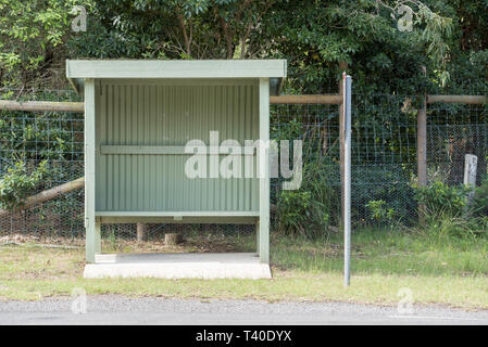 An empty Colourbond steel bus stop in the town of Kioloa near Bawley Point on the south coast of New South Wales, Australia - Stock Image