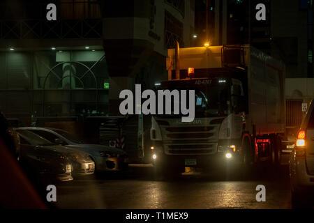 Jan 22, 2019 - Abu Dhabi, UAE: Night shot of Scania truck while collecting waste in Abu Dhabi - Stock Image