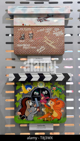 Zlin, Czech Republic. 14th May, 2019. The exhibition of painted clapperboards or otherwise decorated film clapperboards, which will be auctioned during this years 59th Film Festival for Children and Youth in Zlin, was opened in Zlein, Czech Republic on May 14, 2019. Credit: Dalibor Gluck/CTK Photo/Alamy Live News - Stock Image