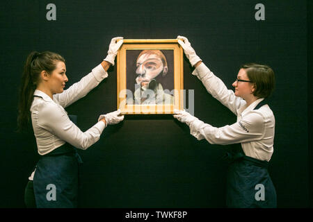 London, UK. 21st June, 2019. Sotheby's assistants with a Francis Bacon, Self Protrait, 1975, Oil on Letraset on canvas. Estimate: £15,000,000-20,000,000 at the Sotheby's Contemporary Art Auction preview for the Evening sale on 26 June Credit: amer ghazzal/Alamy Live News - Stock Image