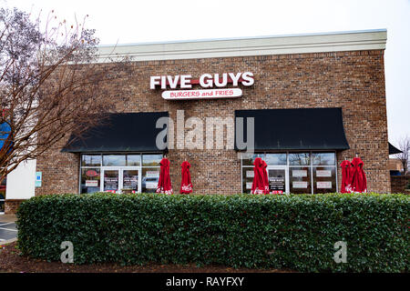 HICKORY, NC, USA-1/3/19: Five Guys is an American fast food restaurant chain, headquartered in Lorton, VA.  With over 1500 locations, many franchised. - Stock Image