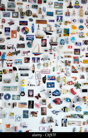 Fridge Magnet collection, showing magnets from around the world. Horizontal version also. - Stock Image