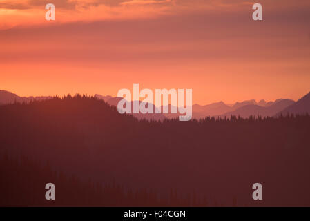 Evening post-sunset sky over mountains - Stock Image
