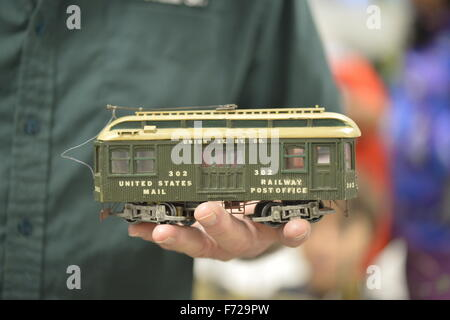 Bethpage, New York, USA. 22nd November 2015. FRANK KOBYLARZ, a co-founder of the Long Island Traction Society, holds - Stock Image