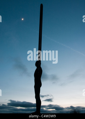 The Angel of the North, apparently trying to reach the moon with an outstretched wing - Stock Image