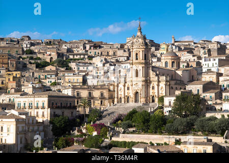 Ancient hill city of Modica Alta and Cathedral of San Giorgio famous for Baroque architecture from Modica Bassa, Sicily - Stock Image