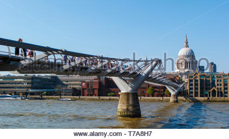 People on the Millennium Bridge between St Pauls and Bankside: London. - Stock Image