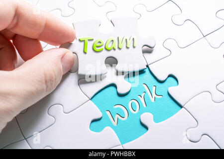 The Words Team And Work In Missing Piece Jigsaw Puzzle - Stock Image