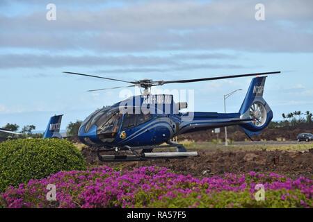Kona, Hawaii - March 22, 2018: Blue Hawaiian Helicopter flies tourists on a scenic tour of the Big Island of Hawaii - Stock Image