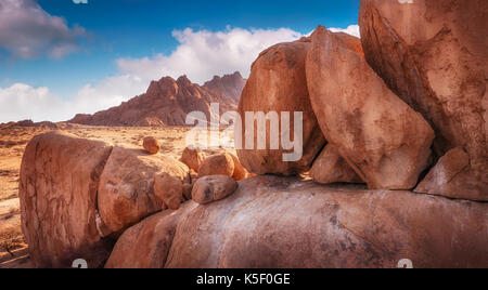 Group of large ancient granite boulders at Spitzkoppe, Damaraland, in the soft morning light of the Namibian desert, Namibia. - Stock Image