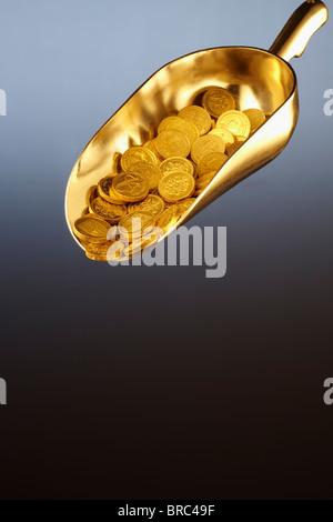 Golden scoop of money - Stock Image