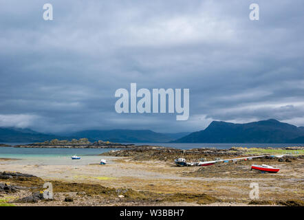 View across Sound of Sleat with moody sky and boats in harbour, Ardvasar, Isle of Skye, Scottish Highlands, Scotland, UK - Stock Image
