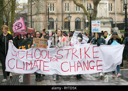 Preston, Lancashire. 15th March, 2019. School strike 4 Climate change as parents and school children assemble outside the railway station. People with banners and placards protesting for 4 action  against climate change.  The demonstrators marched through the city centre to continue their protest at the Flag Market in the city centre. Children from  Lancashire schools have walked out of classes today as part of an international Climate Strike. Credit:MWI/AlamyLiveNews - Stock Image
