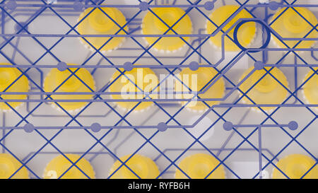 Round silicone switches and PCB on plastic membrane. Disassembled computer keyboard. Abstract technical background. Yellow rubber pushbuttons. Texture. - Stock Image