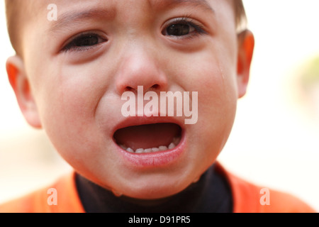 A two year old boy crying - Stock Image