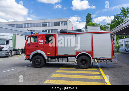 Mercedes Benz 1428AF water tender of a Swiss fire brigade. Truck built 1988 by Mercedes Benz and customized for - Stock Image
