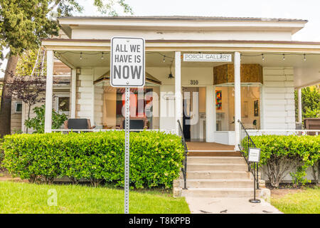 Sign outside an art gallery in Ojai, California: All We Have is Now. - Stock Image