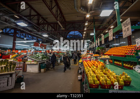 MONTREAL, CANADA - NOVEMBER 9, 2018: Main alley of Marche Jean Talon Market with merchants selling fruits, vegetables and groceries. It is a landmark  - Stock Image