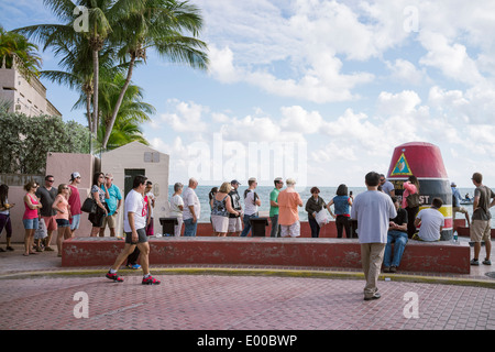 People queueing in order to have chance to photograph themselves at the southernmost point of the US, 90 miles from Cuba. - Stock Image