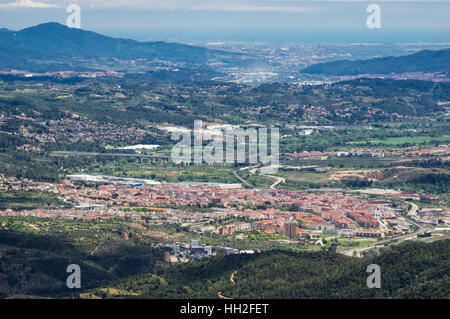 View from Montserrat mountains to the town of Olesa de Montserrat. Province of Barcelona, Catalonia, Spain. - Stock Image